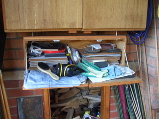 Bottom of vertical cupboard and sandpaper storage cupboard
