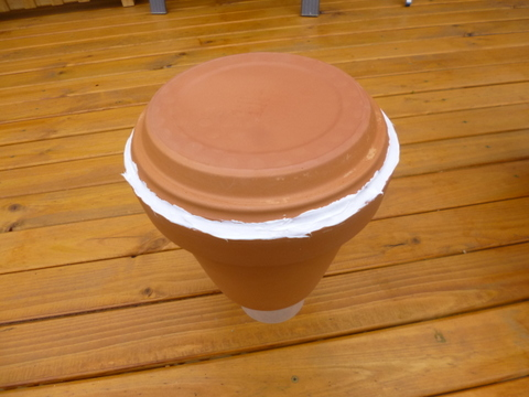 Silicone bead applied to attach saucer to the pot